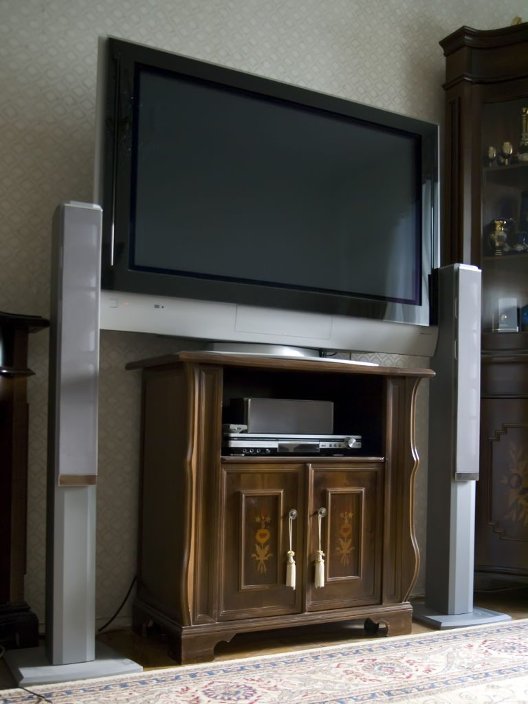 Flat screen on wall in home theater