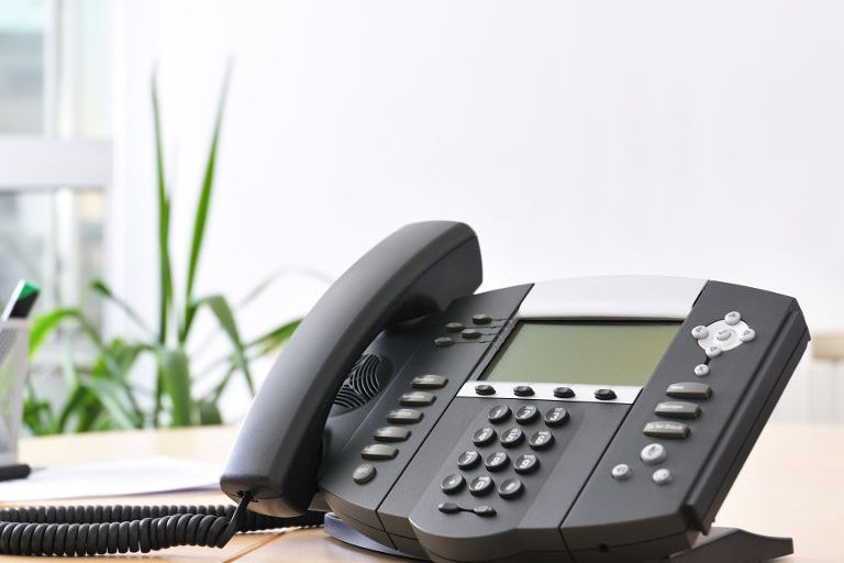 office phone system sitting on desk